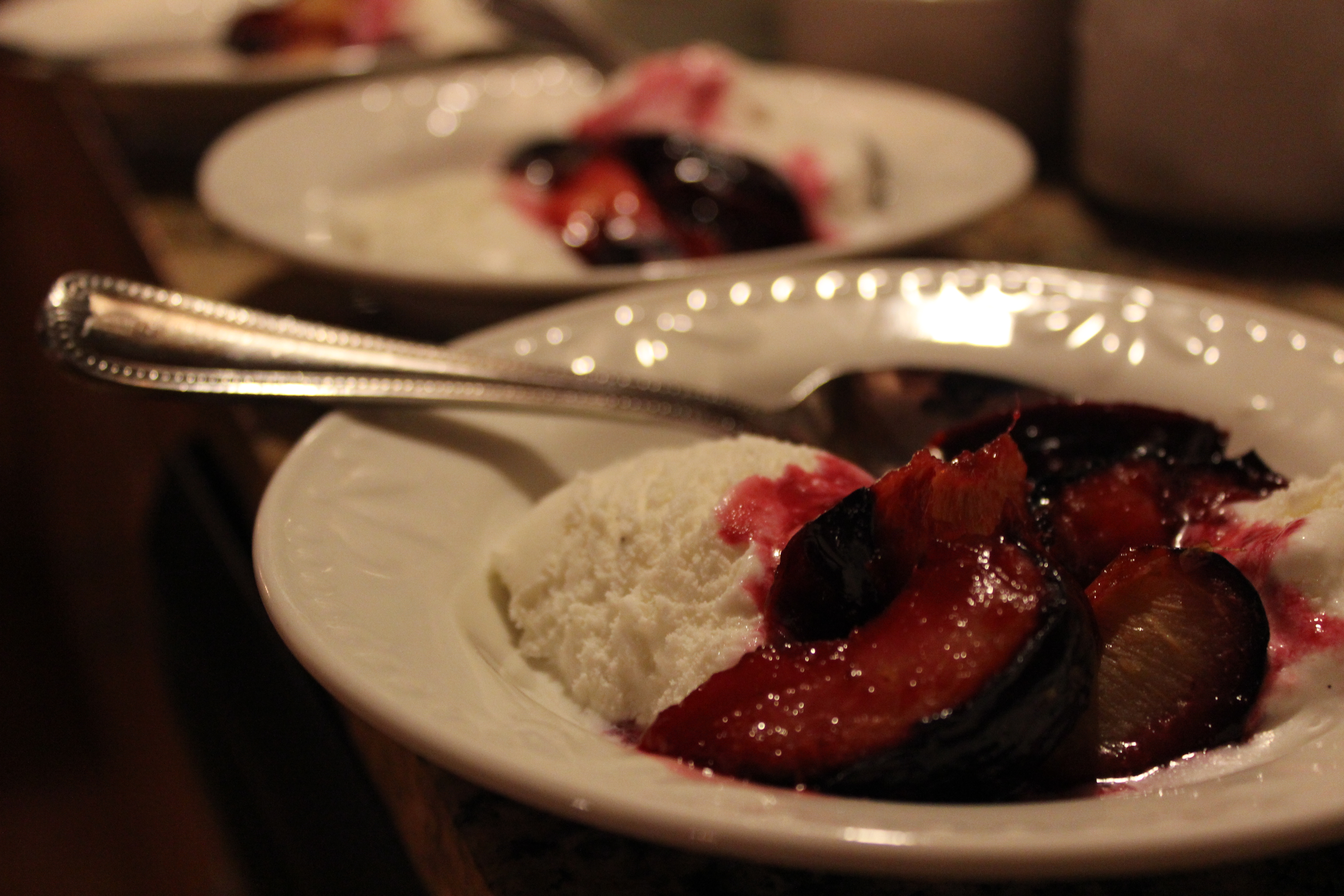 Streusel-Roasted Plums With Vanilla Ice Cream Recipe — Dishmaps